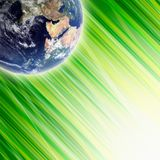 Earth in green grass. Eco global concept - planet Earth in green grass, bright light from below. Elements of this image furnished by NASA Royalty Free Stock Photo