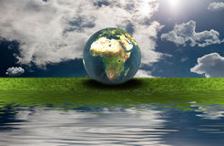 Earth on the green grass Royalty Free Stock Photos