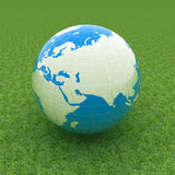 Earth on green grass beautiful 3d illustration Stock Photography