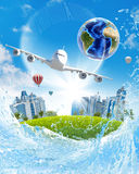 Earth, green grass, buildings and airplane Stock Photography