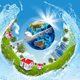 Earth, green grass, buildings, water and airplane Stock Photography
