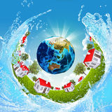 Earth, green grass, houses and water Royalty Free Stock Photo