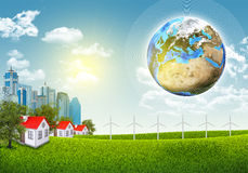 Earth, green grass and town Stock Images