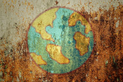 Earth on grunge wall Royalty Free Stock Photos