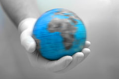 Earth in hand. Earth in gloved hand Stock Image