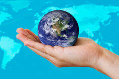 Earth in hand. The earth in the hand of a young child.  (Image of earth used with permission from the NASA website Royalty Free Stock Images