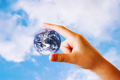 Earth in hand. The future is in the hands of our children - child's hand holding the earth.  (Image of earth used with permission from the NASA website Stock Image