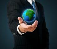 Earth in a hand Stock Photos