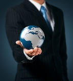 Earth in a hand Royalty Free Stock Photos