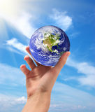 Earth in hand. Planet Earth in hand. Conceptual design Stock Image
