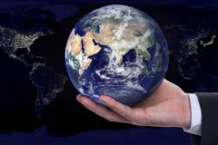 Earth in a hand. On background night city Royalty Free Stock Images