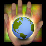 Earth in hand Stock Photos