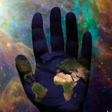 Earth hand galactic. Earth hand in deep space Royalty Free Stock Photography