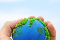 Earth in hand Stock Photography