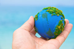 Earth in hand Stock Images