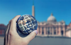 Earth Hand Rome. Earth planet in male hand. Rome St Peter background. Elements of this image furnished by NASA Royalty Free Stock Images