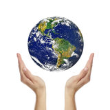 Earth in hands. Isolated on white Royalty Free Stock Images