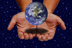 Earth on hands. On space and stars background Royalty Free Stock Photos