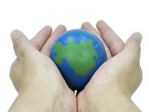 Earth In Hands. Toy earth in both palms Royalty Free Stock Images