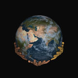 Earth on hands - black Stock Image