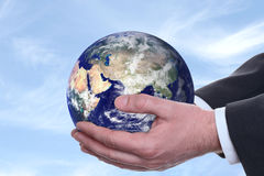 Earth in a hands, blue 2 Stock Image