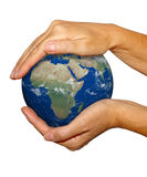 Earth in hands - earth texture by nasa.gov Royalty Free Stock Images