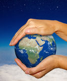 Earth in hands - earth texture by nasa.gov Stock Photo