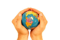Earth in the hands of a man. Looking after the ozone layer - it is in our hands. Global warming will continue unless we act. Earth held in a pair of hands over a Royalty Free Stock Photos