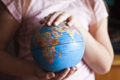 The earth in hands Stock Photo