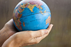 The earth in hands Stock Photography