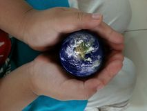 Earth in hands. Stock Images