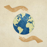 Earth in hands recycled paper craft Stock Photography
