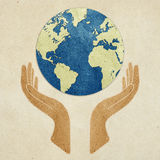 Earth in hands recycled paper craft Stock Photo