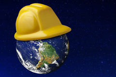Earth Hard Hat Protection Safety Asteroid Universe. Earth wearing yellow hard hat environment or asteroid threat protection against starry universe Royalty Free Stock Photo