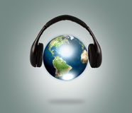 Earth with headphone. Royalty Free Stock Photography