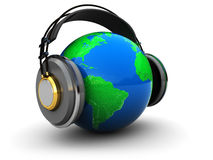 Earth with headphones. Abstract 3d illustration of earth globe with headphones over white background Royalty Free Stock Image