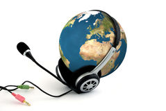 Earth with headphones. Communication concept Stock Images