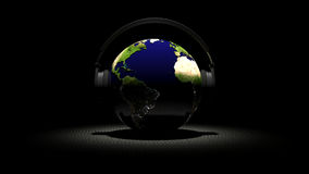 Earth with headphones. 3d rendered planet earth with headphones on black background Royalty Free Stock Photo