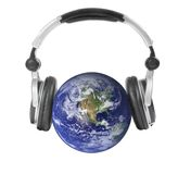 Earth and headphones. Isolated. Stock Photo