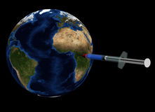 Earth healing. Earth globe healed with an injection, isolated on black Royalty Free Stock Image