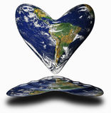 Earth heart. Earth in the shape of a heart with reflection in water Royalty Free Stock Images