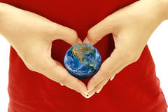 The earth on heart hand ,including elements furnished by NASA Royalty Free Stock Images