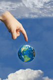 Earth in heaven touched by the hand of god Stock Photos