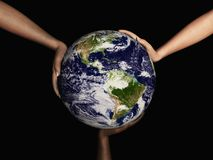 Earth held by 3 Hands. Digital render of Earth being held by three hands with different skin colors Royalty Free Stock Photos