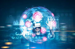 Earth hologram with graphs and vr glasses man Royalty Free Stock Image