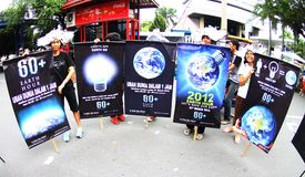 Earth Hour Campaign in Indonesia. A number of environmental activists and artists perform energy saving campaign Earth Hour in Solo, Central Java, indonesia Royalty Free Stock Photos