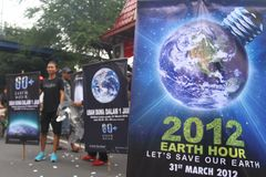 Earth Hour Campaign in Indonesia. A number of environmental activists and artists perform energy saving campaign Earth Hour in Solo, Central Java, indonesia Stock Photography