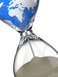 Earth in hourglass. Conceptual image destruction of the world. Stock Photos