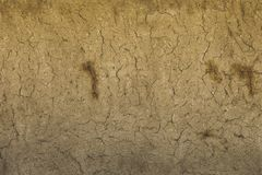 Earth house texture soil wall of traditional house made of clay and straw royalty free stock photography