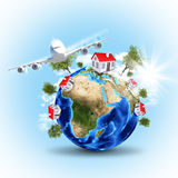 Earth with houses and airplane Stock Photo